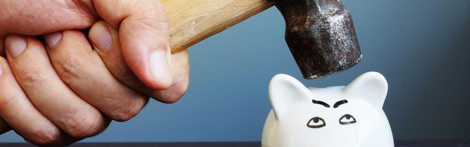 bigstock-Hand-With-Hammer-Above-A-Piggy-255361390_web.jpg