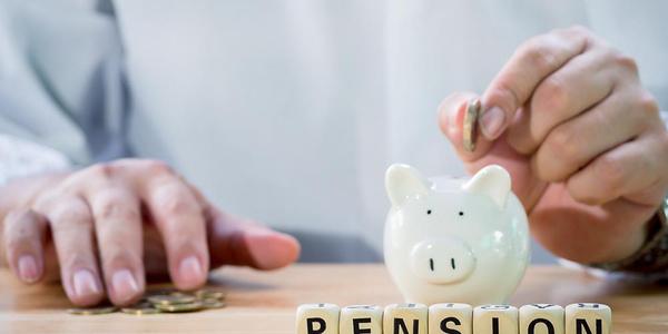 hand puttin coin into piggy bank pensions - web.jpg