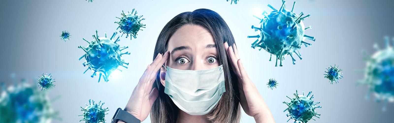 woman scared of coronavirus (350816081)_web.jpg