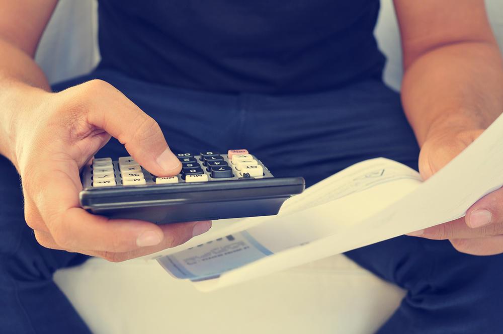 man calculating - apprentice payroll (bigstock 87329072)_web.jpg