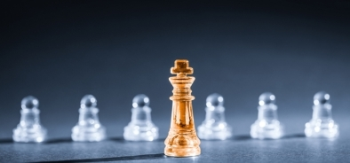 gold chess piece in front_policy_leader_representation (bigstock 115016555)_web.jpg