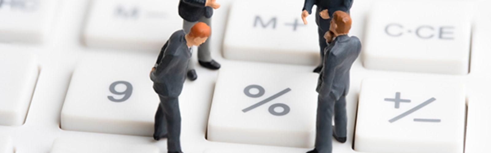Business-Mans-Standing-On-Calc (bs313149565)_.jpg