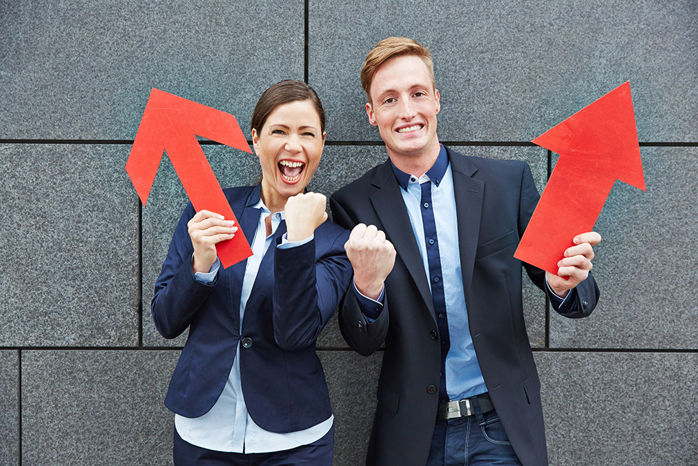 man and woman apprentices with arrows (shutterstock 194962505)_web.jpg